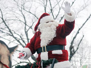 PORT HOPE -- Santa Claus waves to the crowd, which lined Walton and Queen streets in Port Hope during the annual Santa Claus parade on Nov. 30. Dec. 2, 2013.