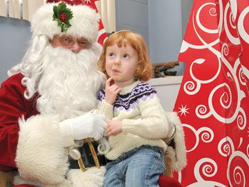PORT PERRY -- The YMCA Lunch with Santa was held at the Port Perry United Church hall. Stella Nesbitt, from Prague, Czech Republic, gave some serious thought to her Christmas wish when she visited Santa. Proceeds from the popular annual lunch benefit the YMCA Strong Kids program. December 18, 2013
