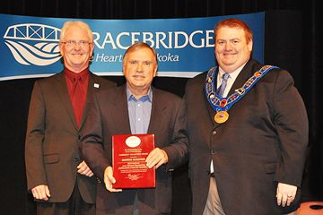 Morris Hudasek received a nomination for the 2014 June Callwood Outstanding Achievement Award and a plaque from the Town of Bracebridge.  L-R Councilor Steve Clement, Chair of Community Recognition Advisory Committee, Morris Hudasek, Mayor Graydon Smith