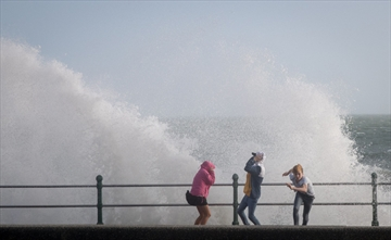 People run from a wave whipped up by Hurricane Ophelia as it crashes over the seafront in Penzance in Cornwall, England. Hurricane Ophelia comes exactly 30 years after the Great Storm of 1987. Two people have been killed as the remnants of the storm hit the United Kingdom and Ireland.
