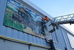 Railroad mural at Richmond arena put back in place