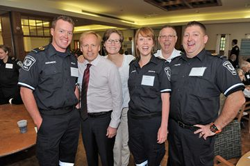 With his wife Colleen standing behind him, survivor Scott Ernst (second from left) shares a moment with EMS personnel Brad McEachnie, Debra Hunter, Terry Irwin and Lee Nordstrom.
