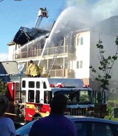 Fire ravages condos in Findlay Creek; Dozens displaced, damage estimat– Image 1