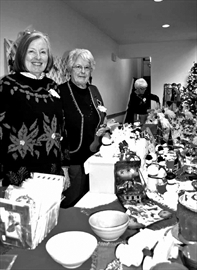 Elienne Chivers and Jean Read help sell some Christmas crafts at the Holly Days bazaar at Christ Church in Bells Corners. The craft event, held on Nov. 16, features gift baskets, wreaths, garlands, knitting and jewelry and also had a silent auction.
