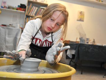 PORT PERRY -- It was a messy job as Alex Petkova tried her hands at throwing a pot on a potter's wheel in an after-school Pottery for Kids with Jeff Timothy at Meta4 Studio. Session two starts on March 20 for six weeks, 4 to 5:30 p.m. The course is open to all potters age 10 and up. Course fee is $130, including all supplies and firings. Contact Meta4 Contemporary Craft Gallery at www.meta4gallery.ca for more information. March 6, 2014
