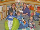 Optimist Club donates to the library