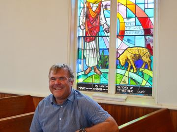 Lorne McArthur, a lifetime member of Rock Chapel United Church, sits in front of a stained-glass window commemorating his parents Bob and Mary at the Rock Chapel Road church. The church will close its doors for the final time Oct. 29. October 17, 2017.