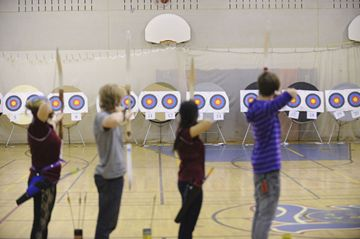 Competitors line up their shots during the city-wide high school archery championship at Riverdale Collegiate April 25.