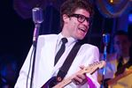 Jeff Giles as Buddy Holly.