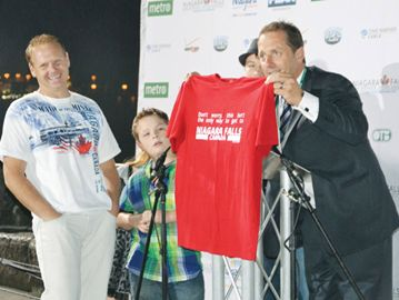 Nik Wallenda has a laugh over a T-shirt presented to him by Niagara Falls Mayor Jim Diodati after Wallenda completed his wirewalk above the Horseshoe Falls last June.