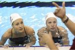 Canada's synchronized swimmers train with weights on their ankles