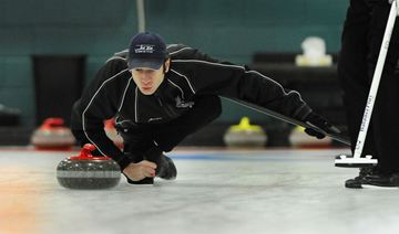 The Weston Golf and Country Club's Aaron Clark lets loose with his rock during Dominion Tankard zone playdowns action against the Royal Canadian Curling Club at Weston Golf and Country Club on Saturday afternoon.  (Dec. 14, 2013)