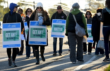 Mohawk College faculty set up pickets out front of the Fennell Avenue campus after contract talks expired at midnight Sunday.