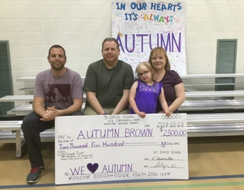 From left, Dave Funnell, Autumn Brown's teacher, Autumn's father, Nathan Brown, Autumn and her mother, Nicole Auger, pose for a photo during the May 25 fundraiser.