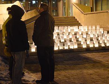 Fleming students hold candlelight vigil
