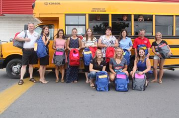 Businesses stuff the bus for Good Backpack