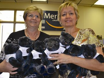 Barb McArthur, manager of Meridian Credit Union in Collingwood gave 25 bears to Karen Potts of the Rainbows program on Monday.