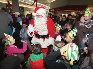 COBOURG -- Shortly after taking part in the Wake up Santa event at the Northumberland Mall on Nov. 16, old St. Nick greeted children and collected letters to Santa. November 19, 2013.