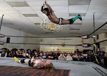 Former WWE wrestler Rich Swann gets airborne before landing on Cody Lane. Alpha-1 wrestling was started by Julian Micevski who is winning acclaim for the well-staged events.