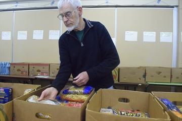 Stoney Creek Community Food Bank volunteer Ben Winter sorts through some of what's left of donations from Christmas.