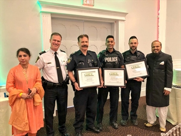 From left, Peel Regional Police Sgt. John Rocha, Cadet Daniel Sheikh and Const. Matthew Pitula were recognized for saving a life last month when they pulled a Mississauga man out of a burning car.