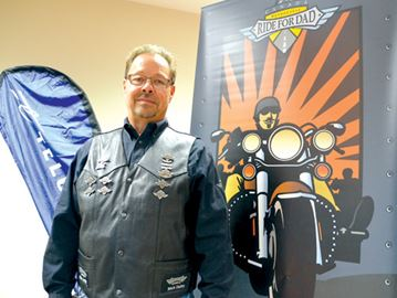 Ready to Ride for Dad Scott Rosts/Staff Photo Damian Parrent is one of the organizers of the Niagara Motorcycle Ride For Dad, which takes place Saturday, May 24. The event helps raises funds to prostate cancer research and helps raise public awareness of the disease.