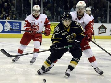 London Knights Owen Macdonald gets in front of Sault Ste Marie Greyhound Jean Dupuy during Thursday (March 6) game at Budweiser Gardens.