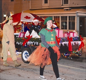 The Gananoque Santa Claus parade was held on the evening of Saturday, Nov. 30. Hundreds lined the sidewalks along King Street, waiting to catch a glimpse of all the lights, floats, bands and of course the big guy himself, seen here at left, with his elves and reindeer. Above, many got into seasonal costumes to celebrate.
