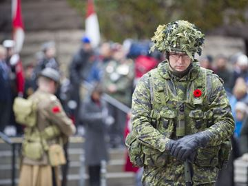 A soldier takes part in a Remembrance Day service at Old City Hall Cenotaph Monday morning. (Nov. 11, 2013)