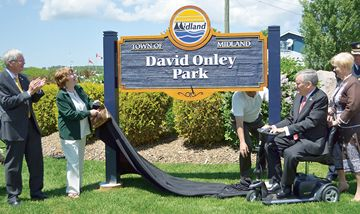 Midland Mayor Gord McKay, left, and Sue McKenzie, chair of the Midland Heritage Committee, help Lt.-Gov. David Onley and his wife, Ruth Ann, unveil the sign for David Onley Park.