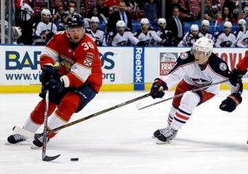 FILE - In this Jan. 14, 2017, file photo, Florida Panthers left wing Jussi Jokinen (36) skates with the puck as Columbus Blue Jackets left wing Matt Calvert (11) defends during the second period of an NHL hockey game in Sunrise, Fla. NHL teams are taking advantage of their final chance to buy out players this offseason. Among the players placed on unconditional waivers for buyout purposes was Jokinen. (AP Photo/Lynne Sladky, File)