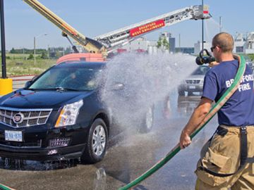 Matt Roberts power washes a vehicle during the Bradford West Gwillimbury Firefighters car wash and barbecue June 15. Proceeds from the event went to Bradford charities.