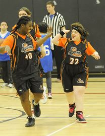 Milton's # 22 Arwa Elhefin ,right, gets congratulated by her teammate #40 Kayla Hall on scoring a basket. This was Milton vs Oakville in non-competitive 'D' action.
