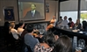 Students and faculty watch the Ontario leaders' debate on TV at the Wilfrid Laurier University pub on Tuesday evening.
