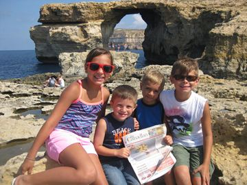 Cousins (from left) Marcella Cunningham, Gabriel Antonucci, Anthony Cunningham and James Bader visit the Aruze Window in Dwejra Gozo, Malta.