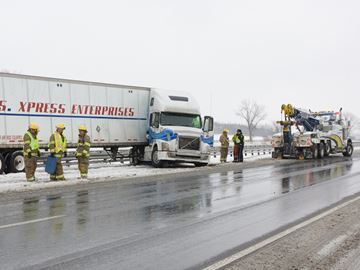 COBOURG --  A tractor trailer jack-knifed on eastbound Hwy 401 between Hwy 28 and Burnahm Street during a wet snowfall on Tuesday. There were no injuries but the fire department attended to control a diesel spill. February 18, 2014.