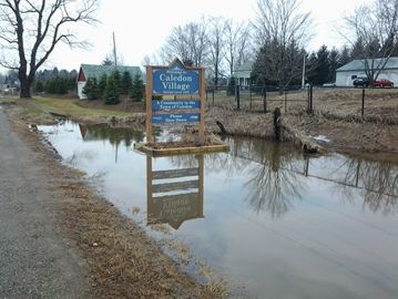 Flooding has been reported in Caledon Village as water levels rise.