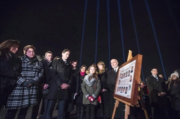 Canadians will commemorate the 28th anniversary today of the Montreal Massacre when a gunman shot 14 women to death and injured 14 other people. Beams of light, one for each victim, shine over Prime Minister Justin Trudeau as he takes part in a memorial ceremony for the fourteen women murdered at Ecole Polytechnique twenty six years ago, in Montreal on Sunday, Dec. 6, 2015. THE CANADIAN PRESS/Paul Chiasson