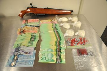 Drugs, weapons, cash seized