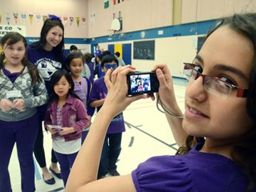 Dorsa Tehrani takes a photograph of her friends with Purple Day organizer Donna Simon March 26 at Richmond Rose Public School in Richmond Hill.