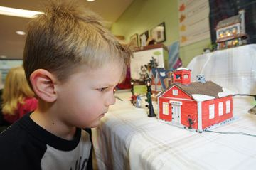 Four-year-old Cole Dreger a student at Sir Adam Beck School checks out a miniature New England Village scene its annual Winter Bazaar on Saturday. (Nov. 30, 2013)