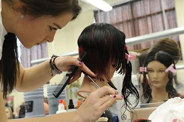 Paige Winterberg of Notre Dame competes in the women's style event of the hairstyling challenge.