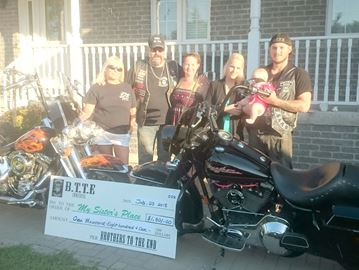 Innisfil motorcycle club donates to Alliston women's shelter