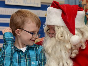 Eli Bomers, 8, has a chat with Santa during the annual Breakfast with Santa at Brookdale Public School on Saturday morning.