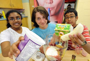 Our Lady of Good Voyage Catholic School held a special day stressing healthy eating and active living on Monday June 17. From left, Mareb Sabu, Michael Cosentino and Ethan Nagasa working on blending smoothies.
