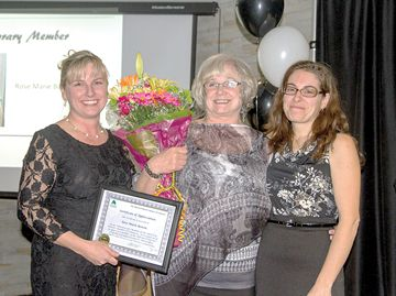 Rose Bowen, centre, was given an honorary life membership to the Alliston and District Chamber of Commerce.