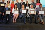 2015 award winners pose with their certificates