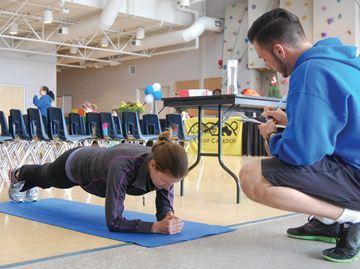 "Stacey Corrigan executes a ""plank"" while instructor Jason Dick checks her form at the Caledon Fitness Fest at the Caledon Centre for Recreation and Wellness."