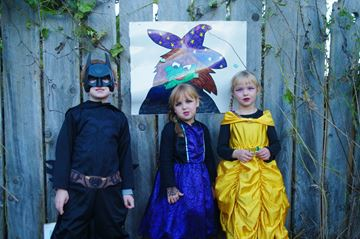 Liam Hudson, 6, Ceilidh Hudson, 5, and Sydney Emery, 5, enjoy the Halloween Spooktacular on Friday evening.