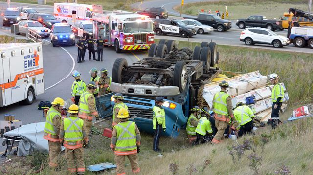 Truck rollover in Burlington sends driver to hospital